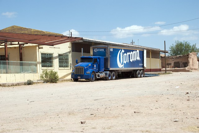 Corona Truck Parked Next to an Abandoned Building