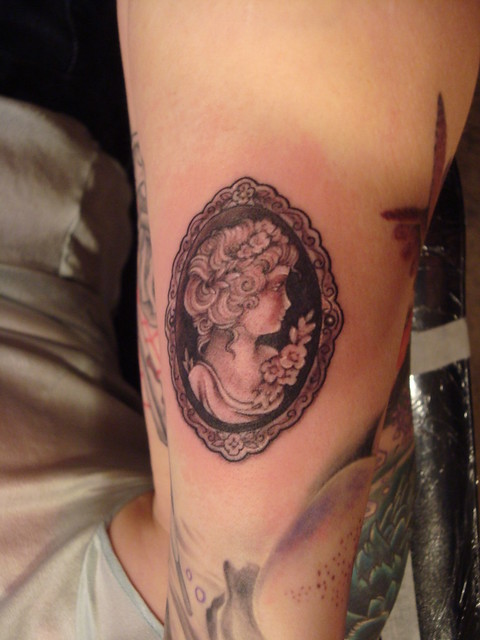 black and grey cameo tattoo
