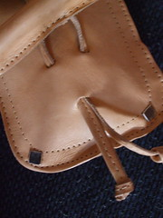 footwear(0.0), coin purse(0.0), rein(0.0), halter(0.0), strap(0.0), bridle(0.0), bag(1.0), brown(1.0), leather(1.0), tan(1.0),