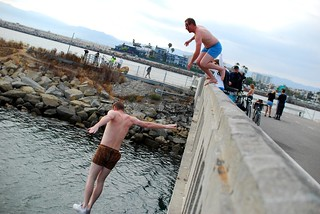 Pier Pressure - Swimmers jumping off a wall into the water.