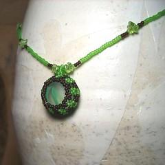 gemstone(0.0), jewellery(1.0), green(1.0), necklace(1.0), pendant(1.0), jade(1.0),