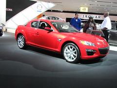 automobile(1.0), automotive exterior(1.0), wheel(1.0), vehicle(1.0), automotive design(1.0), mazda(1.0), land vehicle(1.0), luxury vehicle(1.0), mazda rx-8(1.0), supercar(1.0), sports car(1.0),