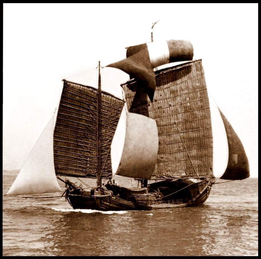 A CHINESE JUNK UNDER FULL SAIL