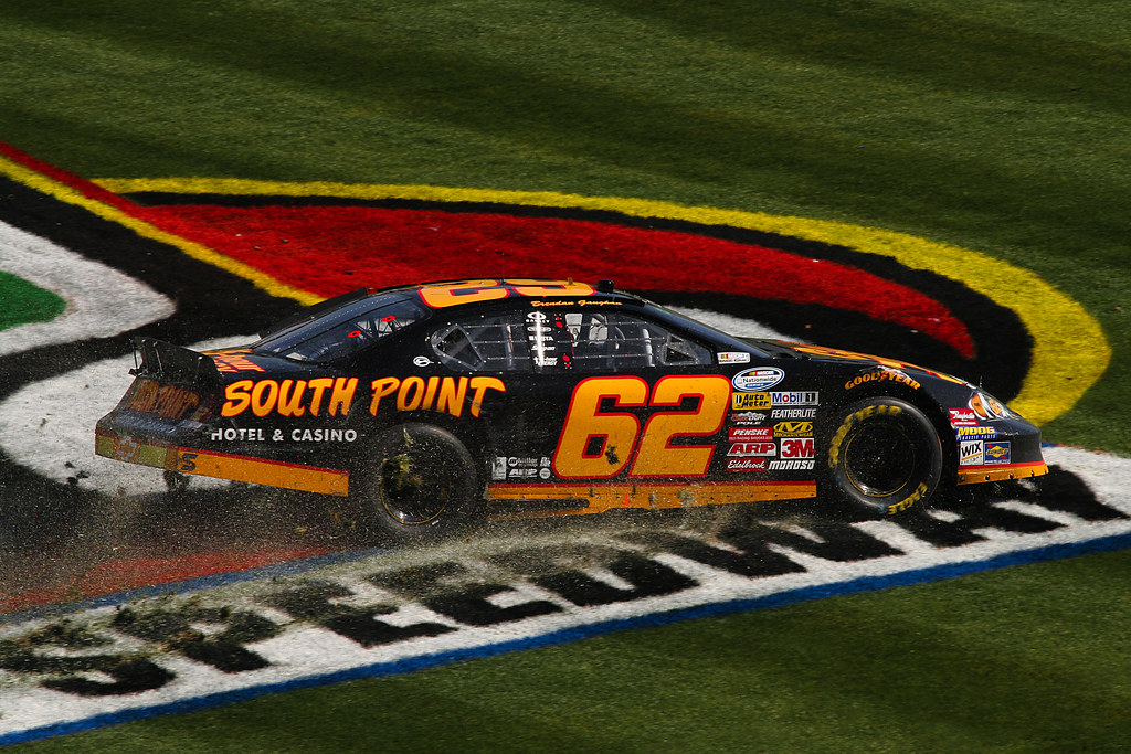 Brendan Gaughan spins across the infield grass at the O'Reilly 300 at Texas Motor Speedway