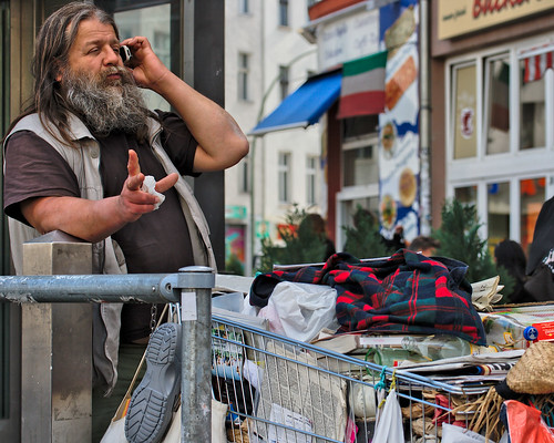 Homeless man on cell phone by Flickr user artie*