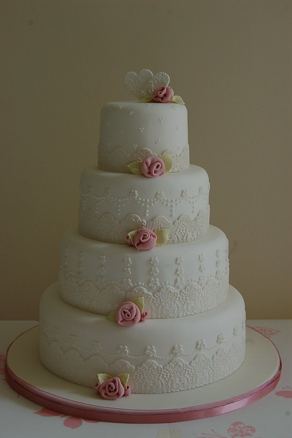Fondant lace wedding cake with ribbon roses by vanessaanne