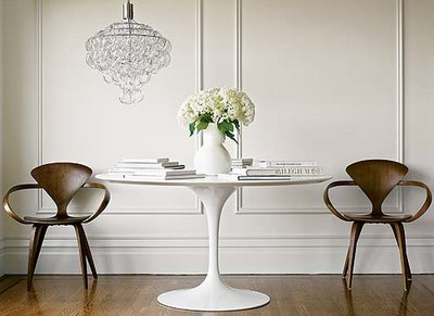 White + wood: Saarinen Tulip table + mid-century modern Norman Cherner chairs