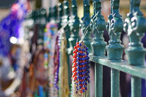 Beads hanging on the fence