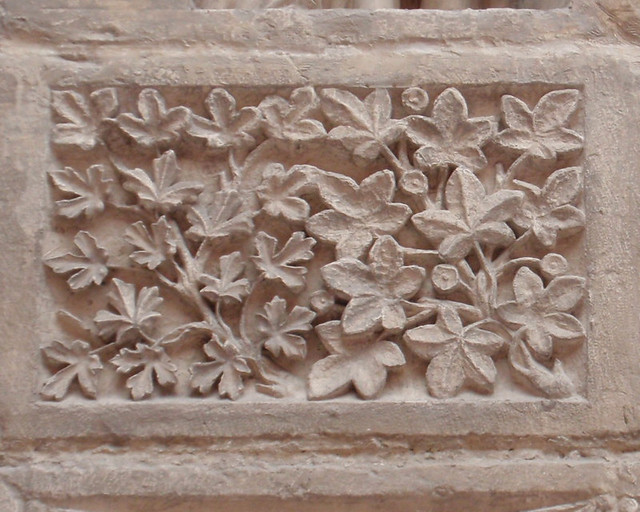 Leaf pattern medieval carved stone relief at the cité