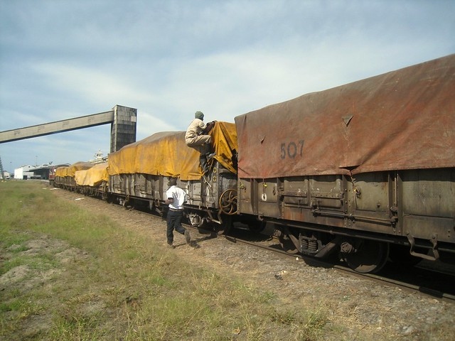 Man climbs aboard wagons being shunted, Port of Maputo, May 22, 2010