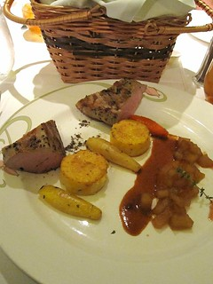 Roasted Pork Tenderloin seasoned with Smoked Salt Citrus flavored Polenta Cakes and Oven Roasted Carrots, Parsnips and caramelized Granny Smith Apples