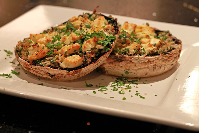Baked Field mushrooms topped with bread crumbs, herbs & fetta cheese ...