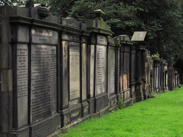 tombstones in a row at a cemetery in Scotland