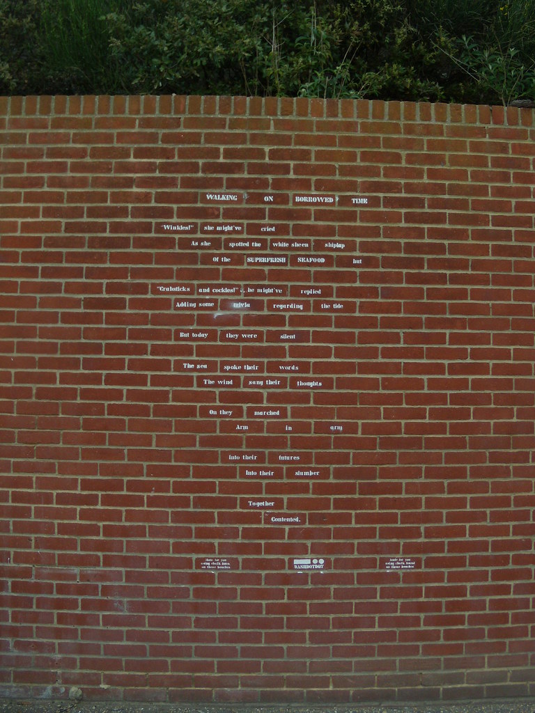 Writing on the wall, Eastbourne A poem, stencilled with chalk from the beach. Seaford to Eastbourne