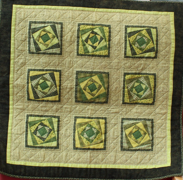 Twisted log cabin mini patchwork quilt