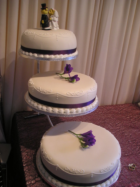 Ivory Purple piped wedding cake