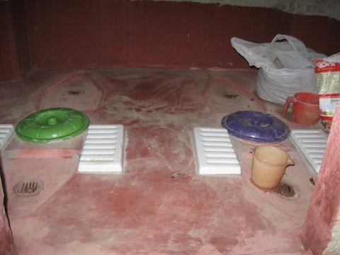 a composting toilet with separate urinal, washing area and plastic lids