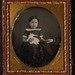Girl with doll, holding mother's hand by George Eastman Museum