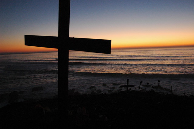 Cross, cross and rocks, sunset, Bodhisattva Beach, north of Mavericks, waves roll in, California coast, USA