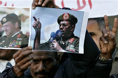 Sudanese masses hold posters of President Omar al-Bashir in a demonstration protesting the arrest warrant issued by the ICC. The government has dismmised the warrant as an imperialist plot to overthrow the state. by Pan-African News Wire File Photos