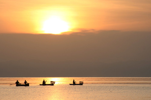 lake water sunrise boats dawn malawi martienvanasseldonk grouptripod