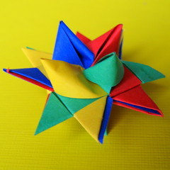 art paper(0.0), flower(0.0), wheel(0.0), origami paper(0.0), petal(0.0), art(1.0), origami(1.0), paper(1.0), craft(1.0),