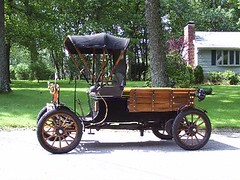 ford quadricycle(0.0), horse and buggy(0.0), vintage car(0.0), ford model t(0.0), automobile(1.0), wheel(1.0), vehicle(1.0), ford model tt(1.0), land vehicle(1.0), carriage(1.0),