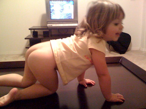 She just took her diaper off and jumped on the table.