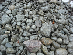 stone wall(0.0), soil(0.0), stream bed(0.0), flooring(0.0), boulder(1.0), rubble(1.0), cobblestone(1.0), pebble(1.0), rock(1.0), gravel(1.0),