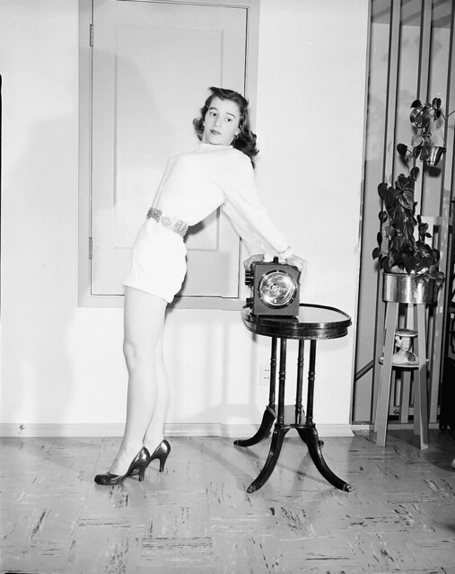 1953, INSTRUMENT SHOW PUBLICITY WITH MYRA MCMILLIAN - POSING WITH INSTRUMENT AT MR. SNORF'S HOUSE