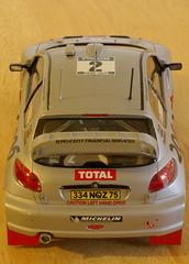 race car(1.0), model car(1.0), automobile(1.0), automotive exterior(1.0), peugeot(1.0), vehicle(1.0), automotive design(1.0), mid-size car(1.0), peugeot 206(1.0), compact car(1.0), bumper(1.0), land vehicle(1.0), sports car(1.0),