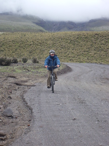 Kathy biking down the Volcano