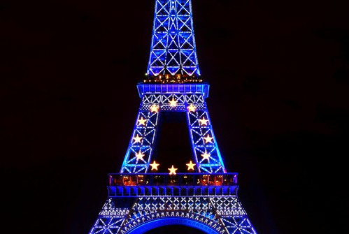 Detaile view of Eiffel tower in blue, at night (Paris)