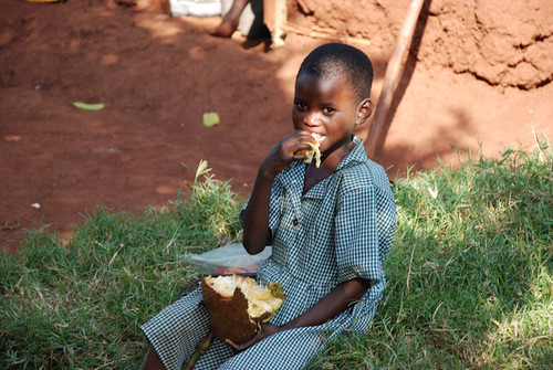 African boy eating