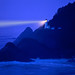 Lighthouse beams across stormy night sea - Heceta Head, Oregon Coast
