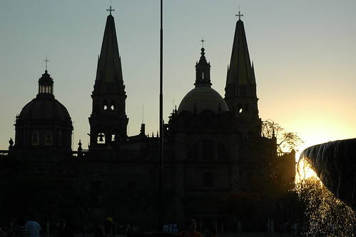 A view of Guadalajara Cathedral and Fountain at sunset, water splashing joyfully in the setting sun, Guadalajara, Jalisco, Mexico by Wonderlane