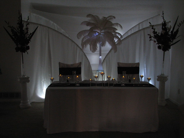 A couple of other wedding reception decoration ideas are to use tower vases