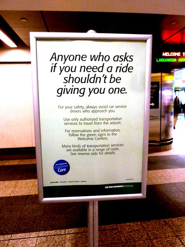 Anti-gypsy-cab sign, La Guardia Airport, NYC, NY, USA.JPG