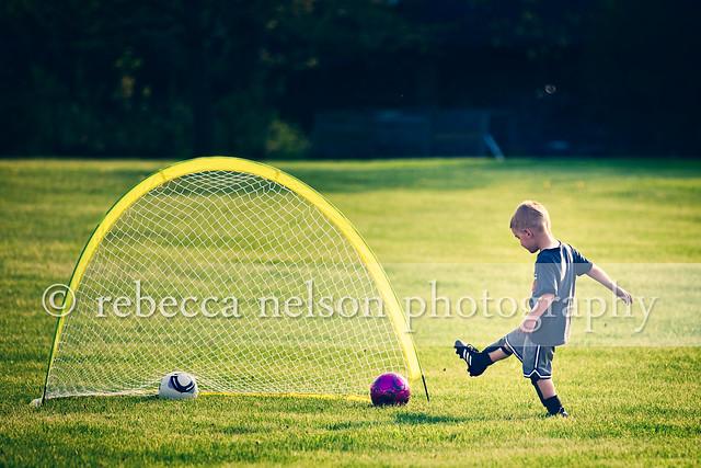 boy kicking soccer ball into goal flickr photo sharing