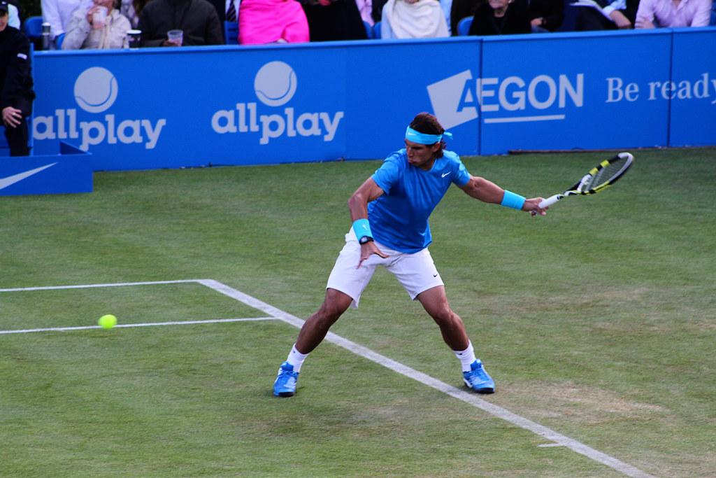 """<a href=""""http://tennis-buzz.com/2011-queens-rafael-nadal-pics/"""" rel=""""nofollow"""">tennis-buzz.com/2011-queens-rafael-nadal-pics/</a>"""