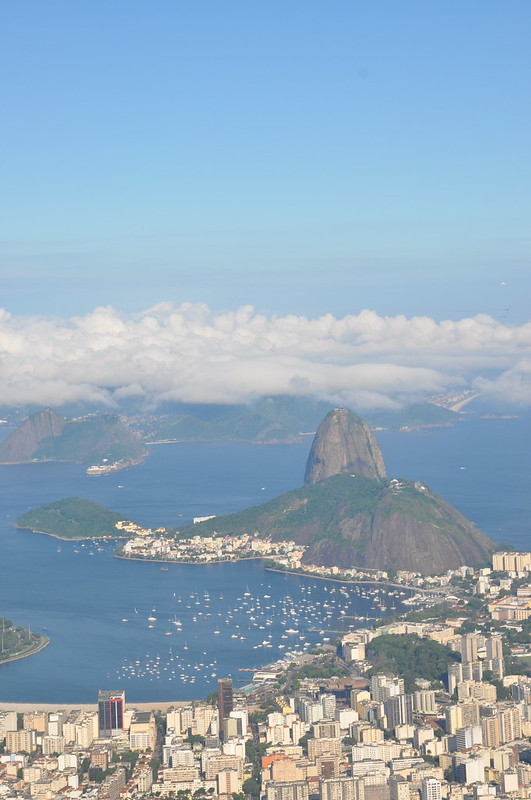Mike Vondran at Christ the Redeemer, Corcovado, Rio de Janeiro, Brazil, December 30 2008. This photo has Sugar Loaf and Copacabana.
