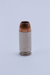 glass bottle(0.0), drinkware(0.0), bottle(0.0), ammunition(1.0),