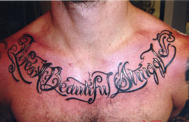Badass tattoos a gallery on flickr for Chest tattoo writing