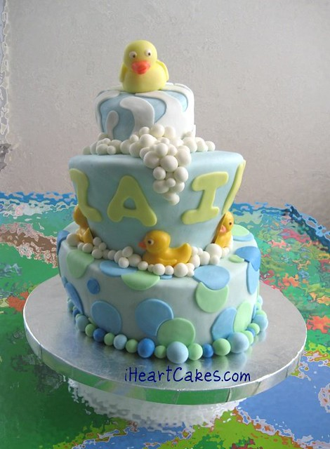 rubber ducky topsy turvy baby shower cake iheartcakes flickr
