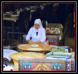 ~ONE  OF THE LOCAL WOMEN MAKING FLATBREAD~