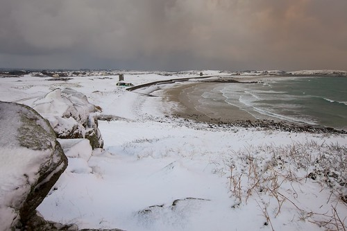 winter snow seascape cold beach bay guernsey lancresse
