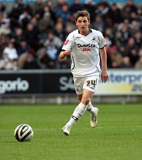 Joe Allen in action for Swansea City.