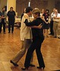 Richard Powers and Joan Walton demonstrate the Argentine tango by performing arts roundtable