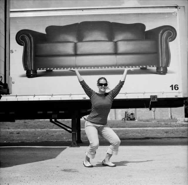 amanda lifts a couch
