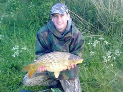 12lb common carp from Moss Lake. Caught on half tiger nut boille with half of small pinapple boillie by John Taylor.